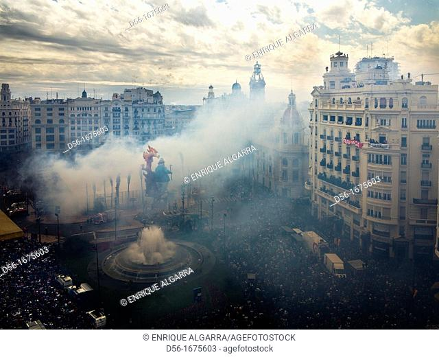 Smoke covers City Hall square during 'Mascletà' fire works, 'Fallas' festival. Valencia. Spain, March 2012