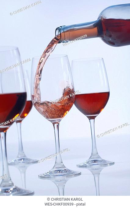 Pouring rose wine in rose wine glasses