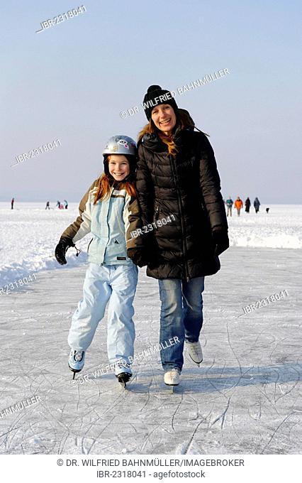 Mother and daughter ice skating near St. Heinrich, Lake Starnberg, Five Lakes region, Upper Bavaria, Bavaria, Germany, Europe