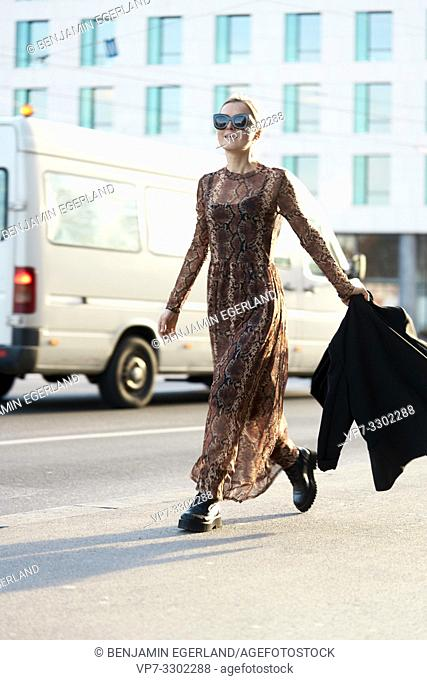 fashionable woman walking at street in city, in Munich, Germany