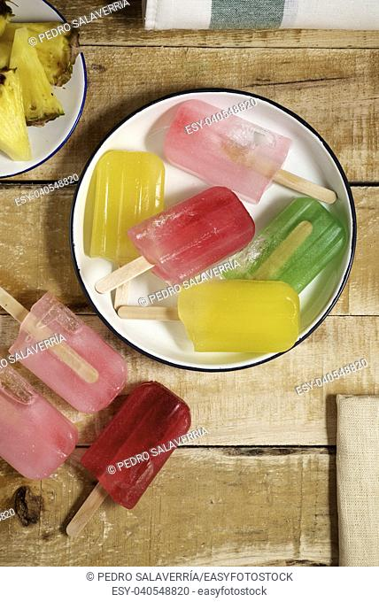 Popsicles on a wood table