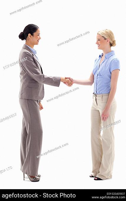 Women shaking hands happily