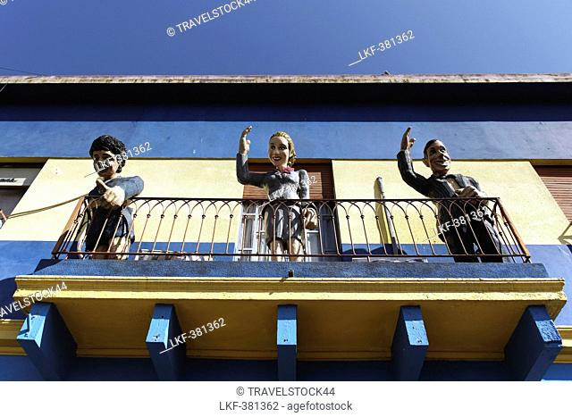 Carlos Gardel, Diego Maradonna, Evita Peron on balcony in La Boca, Buenos Aires, Argentina
