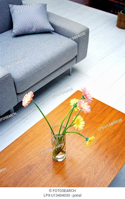 Close Up Image of a Living Room With Some Flowers on the Living-room Table, High Angle View, Side View