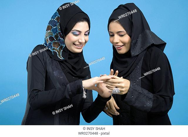Two Arab Ladies looking at jewelry
