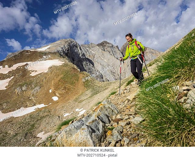 Woman hiking in the High Pyrenees, mount Vignemale, Cauterets, France