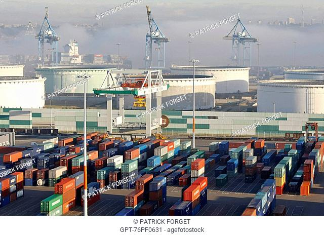 CONTAINER STORAGE ZONE AND OIL TANKS ON THE TERMINAL OF FRANCE PORT 2000, LOADING GANTRY IN THE MORNING FOG, COMMERCIAL PORT, LE HAVRE, NORMANDY, FRANCE