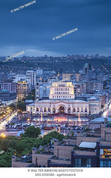 Armenia, Yerevan, Republic Square and skyline, high angle view, dusk