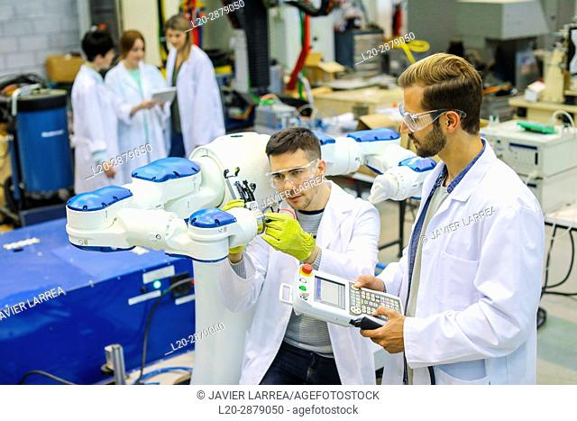 Two-arm robot for industrial handling. Researchers working on robot, Industry, Research and Technology Center, Tecnalia Research & Innovation, Donostia