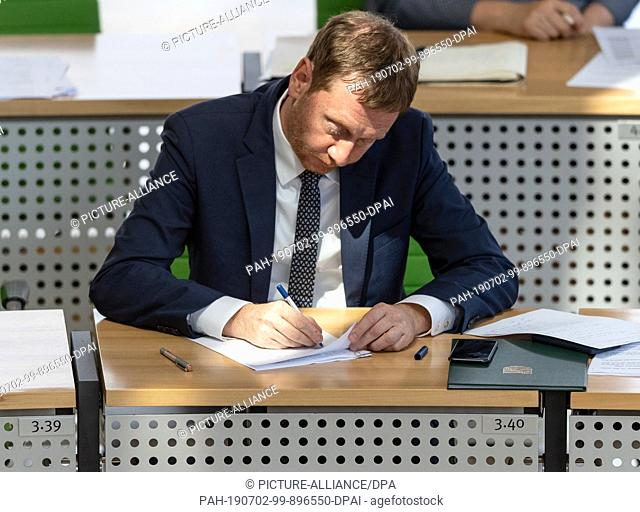 "02 July 2019, Saxony, Dresden: Michael Kretschmer (CDU), Prime Minister of Saxony, sits after his government explanation to the topic """"We arrange Saxonia -..."