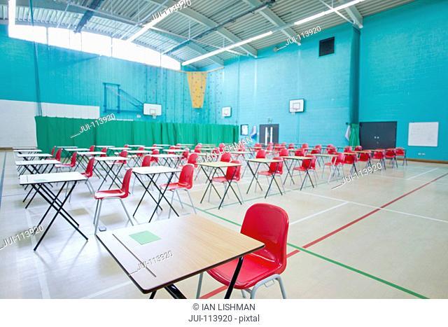 Desks in rows in school gymnasium
