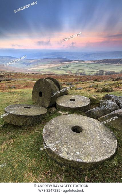 The abandoned millstones on Stanage Edge in the Peak District National Park captured at sunrise in late March. A long shutter speed was utilised to blur the...