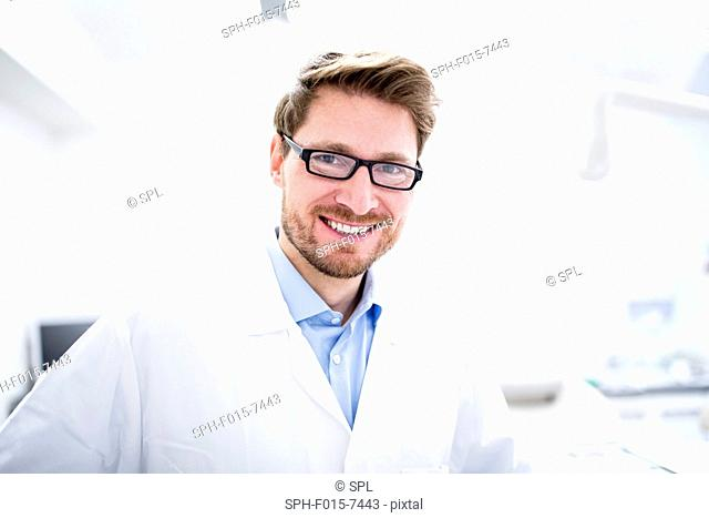 MODEL RELEASED. Close-up of dentist, portrait, close-up
