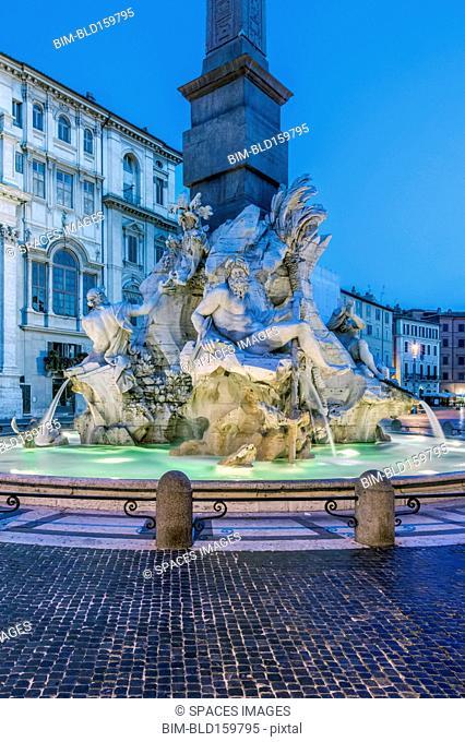 Four Rivers Fountain illuminated at night, Rome, Italy