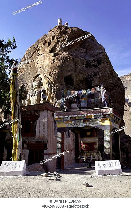 The famous Chamba Statue carved into the rock at the Mulbek Gompa. The impressive eight meter (21 ft.) high figure carved into the rock face pictures a standing...