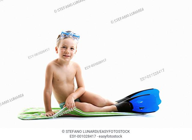 Cute toddler boy with diving mask and flippers on white, lot of copy-space