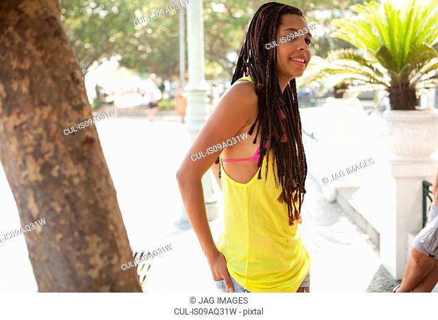 Young woman chatting on sidewalk, Copacabana, Rio De Janeiro, Brazil