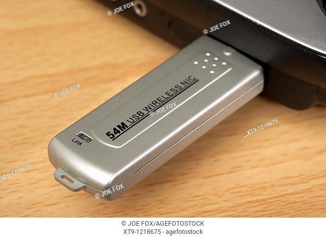 54M wireless usb stick connected to a laptop computer