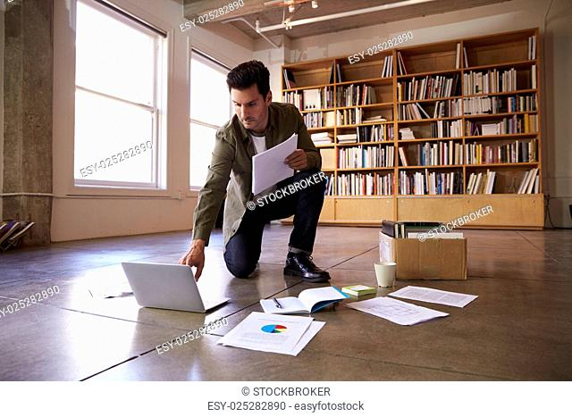 Businessman Laying Documents On Floor To Plan Project