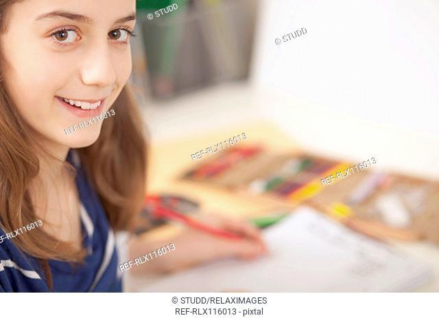 Girl sitting at desk doing homework