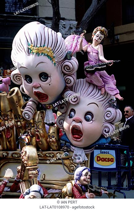 Fallas. Annual street festival. 13 to 19 March. Papier mache figures on floats. Giant heads. Ninots