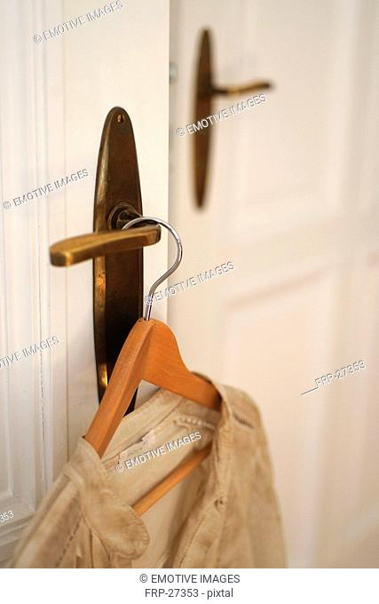 Dress on clothes hanger by the door