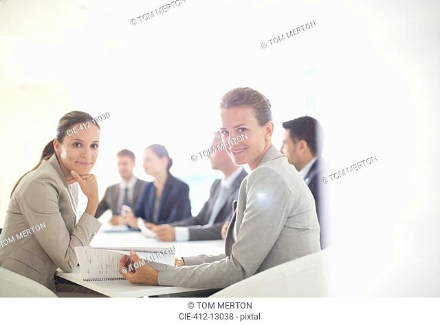 Portrait of confident businesswomen in conference room