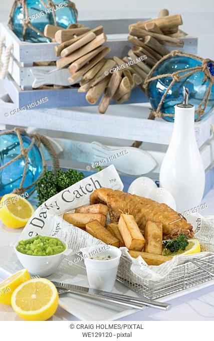Fish and chips served in a newspaper in a restaurant