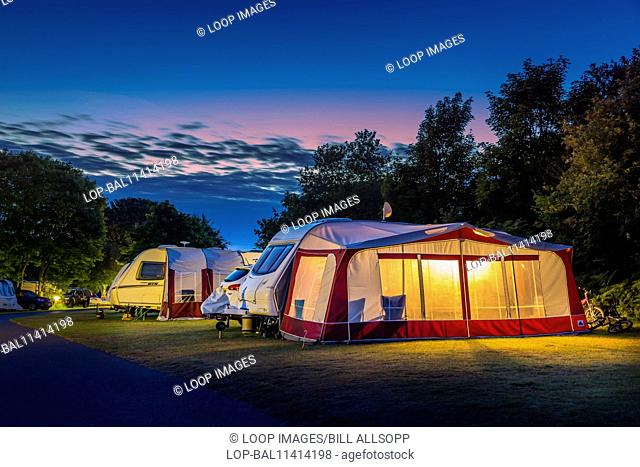 Caravan with awning at nightfall