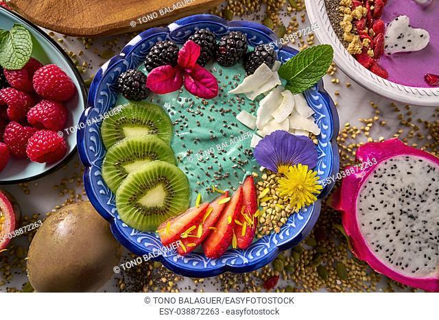 Acai bowl smoothie with kiwi blackberry strawberry and chia seeds dragon fruit