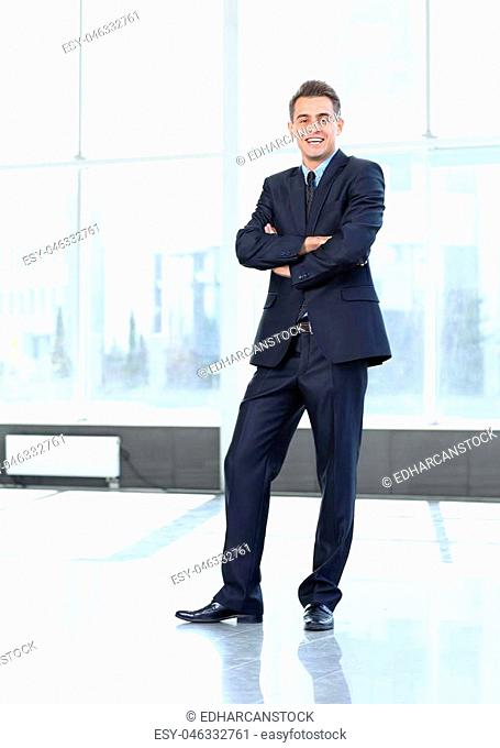 confident businessman standing in the spacious lobby of the office. photo with copy space