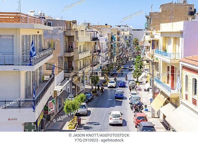 View down busy shop fronted Evans St. in Heraklion, Crete, Greece