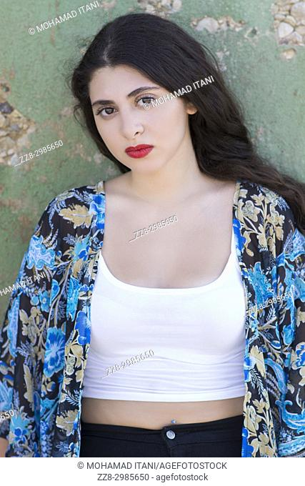 Beautiful young Lebanese woman staring outdoors