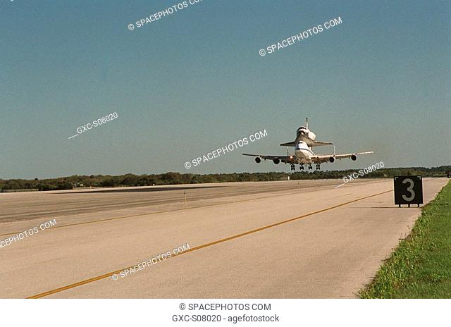 03/06/2001 --- The Shuttle Carrier Aircraft with orbiter Columbia on top prepares to land at the KSC Shuttle Landing Facility after leaving the Cape Canaveral...