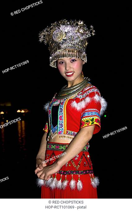 Portrait of a young woman smiling, Guilin, Guangxi Province, China
