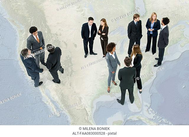 Executives chatting while standing on map of the United States