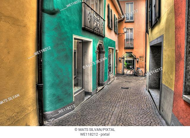 Old colorful alley with stone street