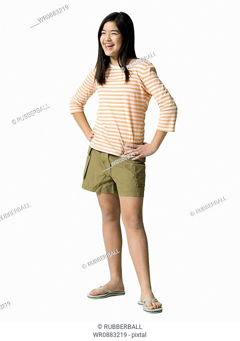 Teenage girl standing with her hands on her waist