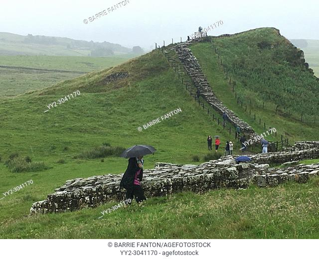 Tourists Visiting Hadrian's Wall During Rainy Weather, Northumberland, England