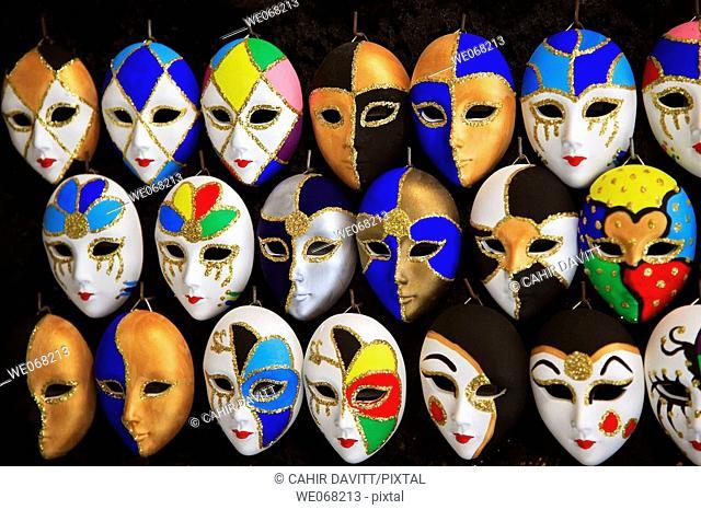 Venetian carnival mask display in a market near Rialto, San Polo, Venice, Veneto, Italy