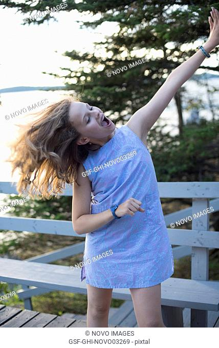 Teenage Girl Dancing on Deck