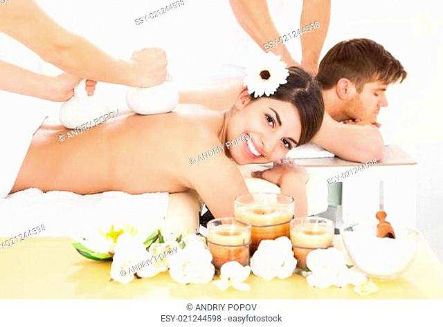 Woman Receiving Massage With Herbal Compress Stamps