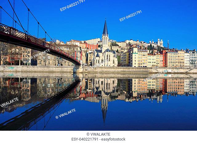 Famous view of Saone river and footbridge in Lyon city, France