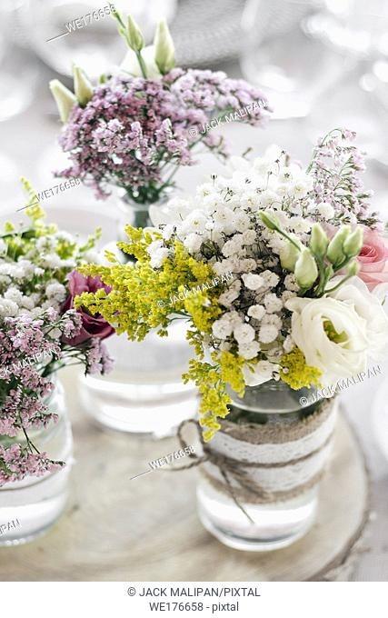 flowers arrangement and decoration rustic interior design in wedding table detail