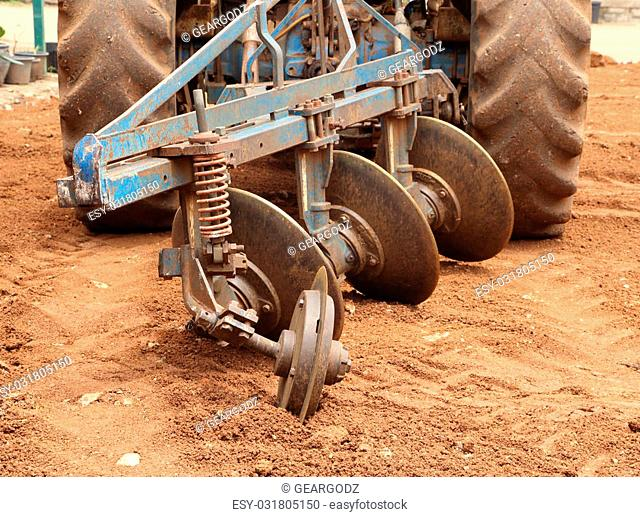 Close-up Tractor plow on red soil, Thailand