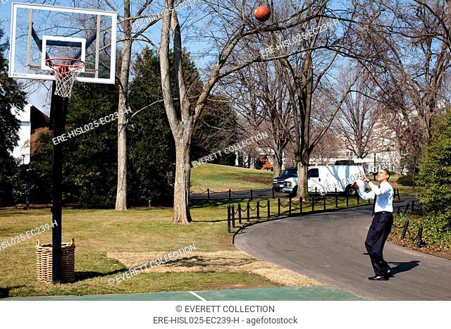 President Obama shoots hoops on the White House South Lawn basketball court March 6 2009., Photo by: Everett Collection(BSLOC-2011-7-280)