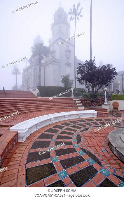 Hearst Castle, America's Castle, in a fog with palm trees, San Simeon, Central California Coast