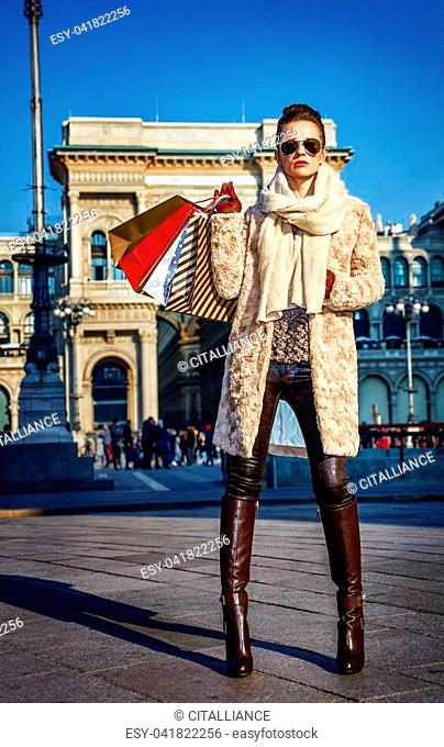 Rediscovering things everybody love in Milan. Full length portrait of elegant tourist woman with shopping bags in Milan, Italy standing