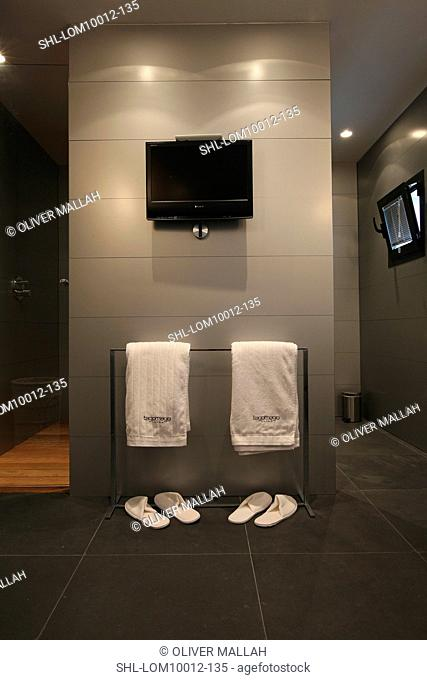 His and her towels and slippers in bathroom