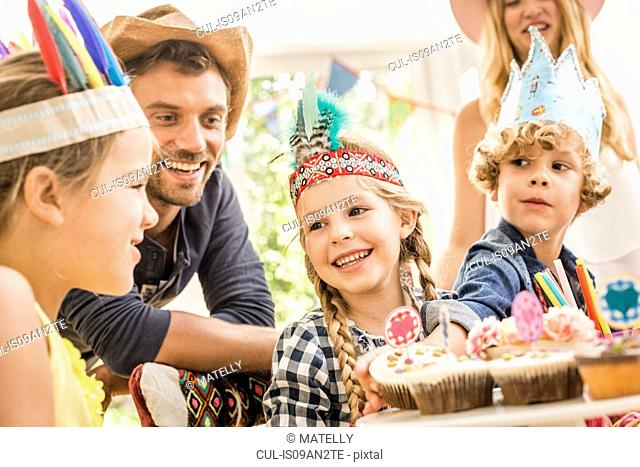 Parents and children at kids birthday party